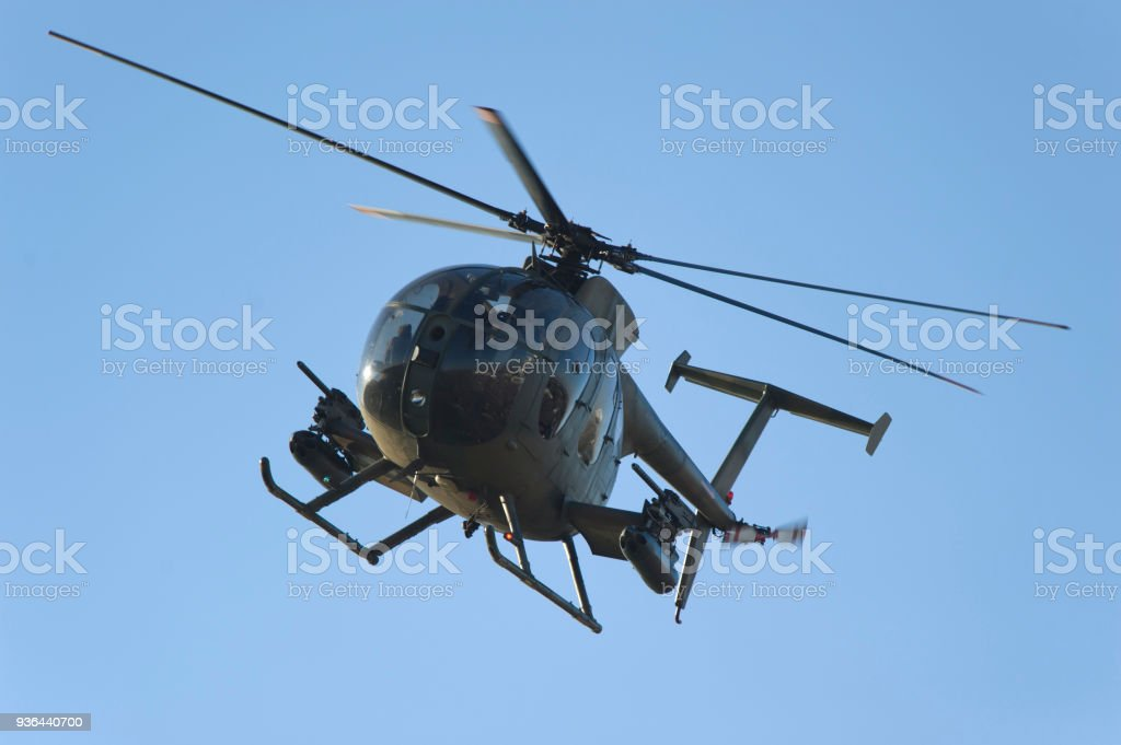 An Armored Combat Helicopter in Flight stock photo