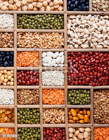 composition of grain, seeds and  legumes in a wood tray, perpendicular texture