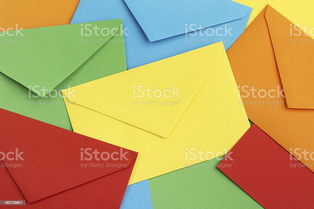 An array of bright and colorful envelopes in five colors stock photo