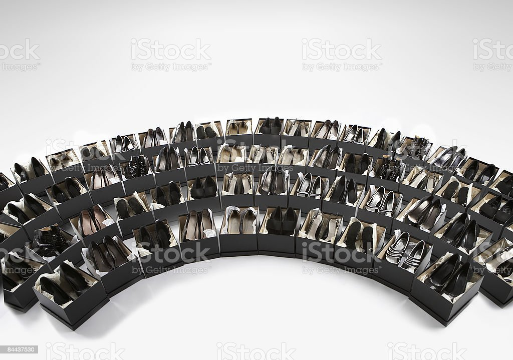 an array of various black shoes in boxes royalty-free stock photo