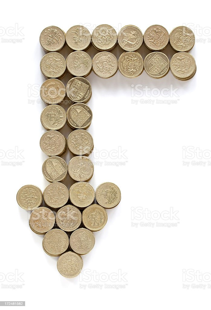An arrow comprised of pound coins royalty-free stock photo