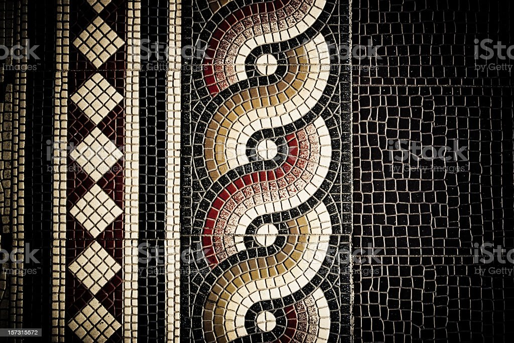 An art deco floor tile in shades of brown royalty-free stock photo