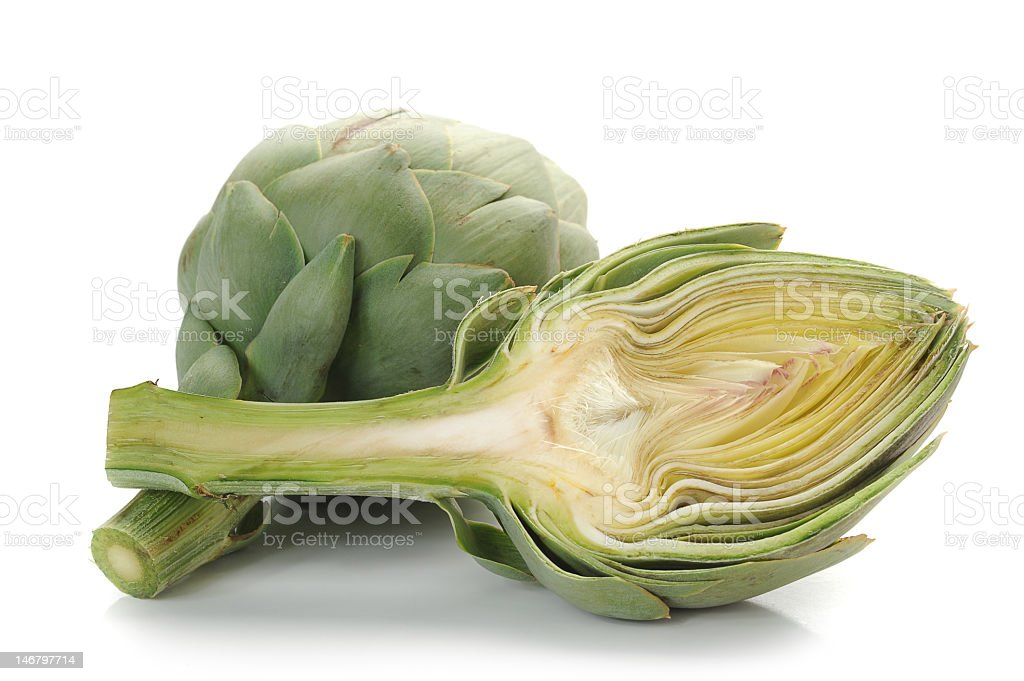 An artichoke cut in half on a white background stock photo