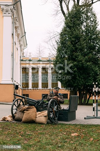 Gomel, Belarus - November 7, 2017: Soldier of the White Guard for the gun charges. Reconstruction of the Great October Revolution in Russia