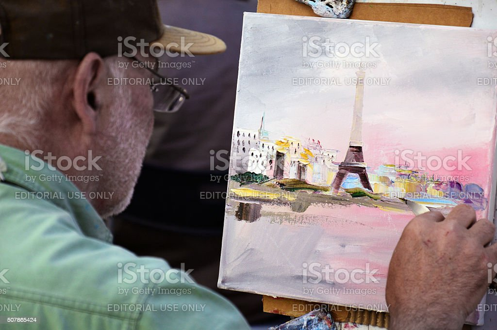 An artist drawing at Place du Tertre, Montmartre stock photo