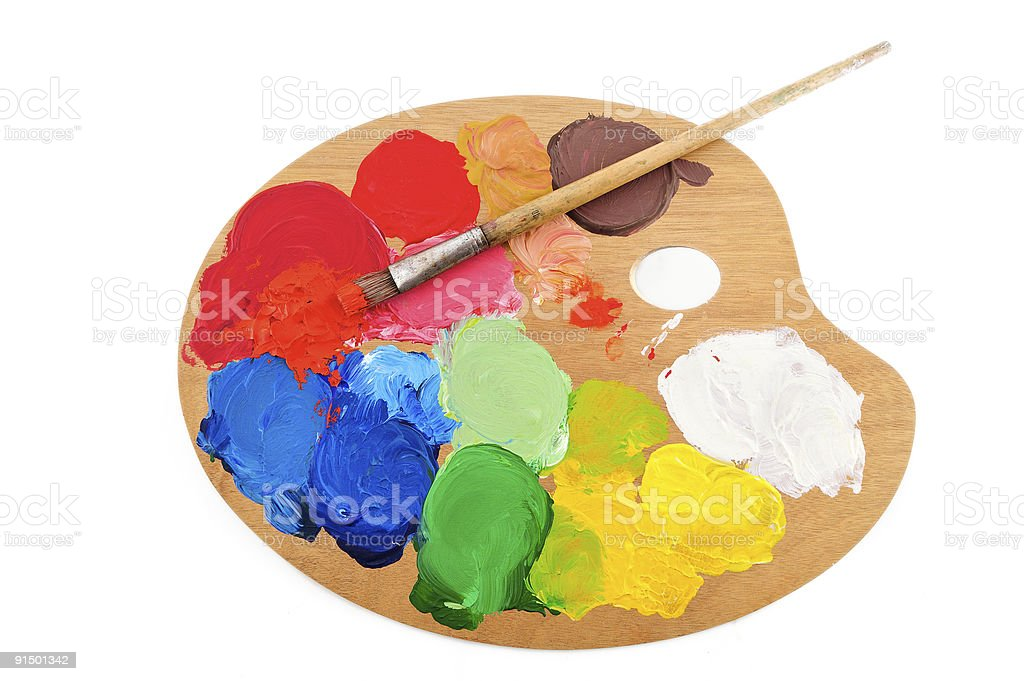An artist palette with paint and paint brush stock photo