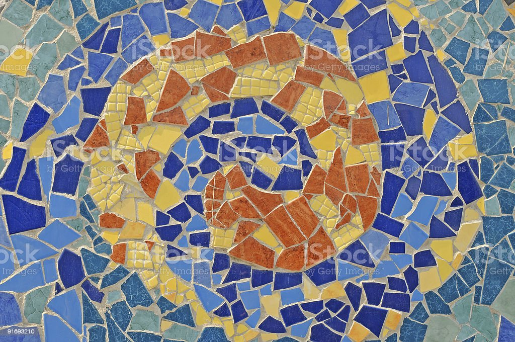 An artistic mosaic wall from broken ceramic tiles stock photo