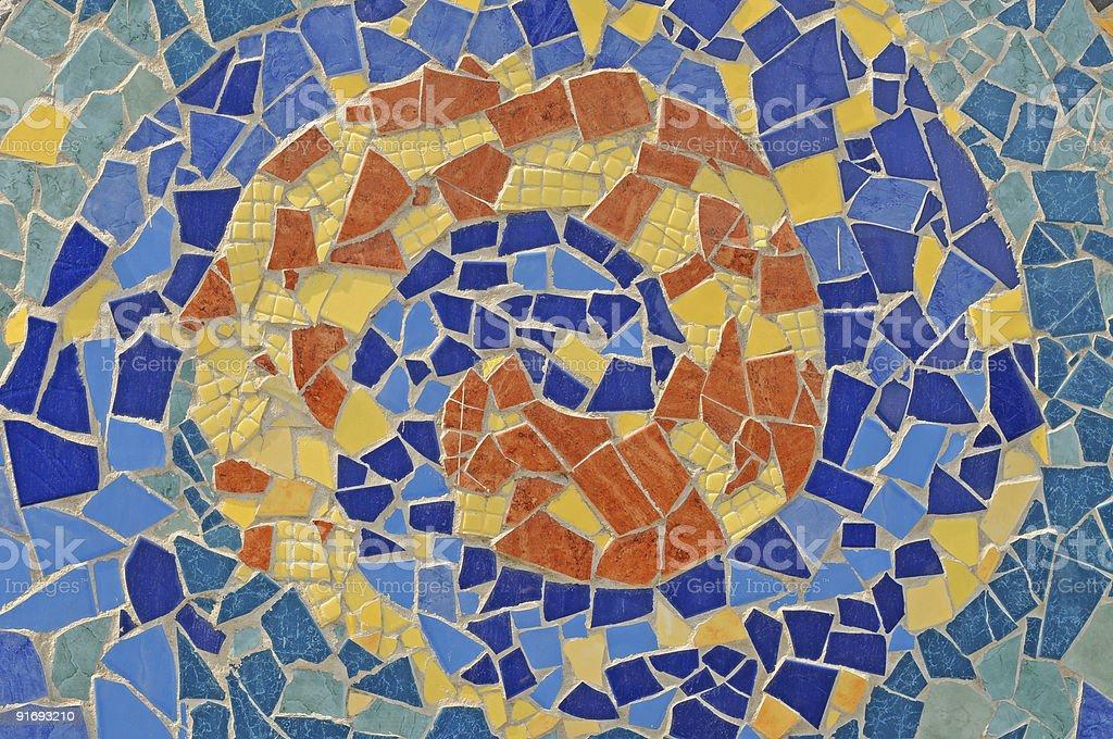 An artistic mosaic wall from broken ceramic tiles stock photo