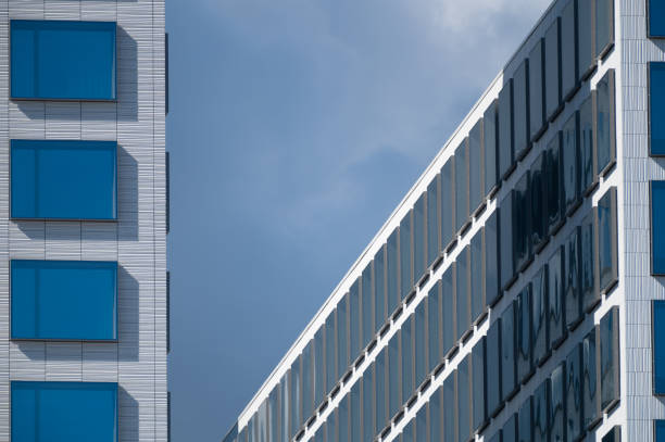 An artistic view two modern buildings with blue glass windows. stock photo