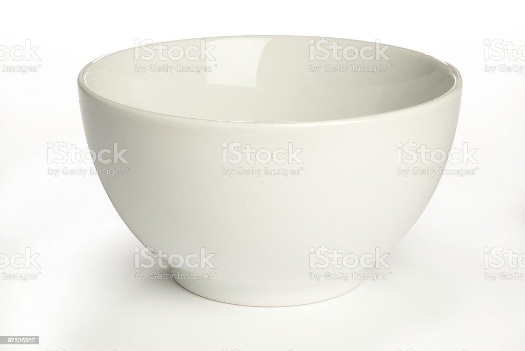 An artistic white ceramic bowl on a white background stock photo