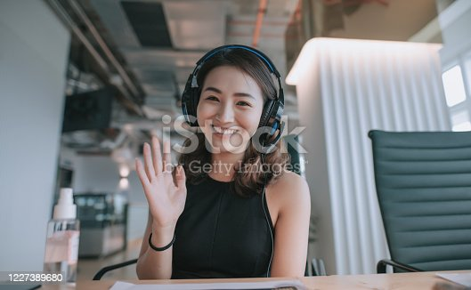 istock an asian chinese beautiful woman white collar worker talking to the camera video calling video conference with his business partners  with face mask 1227389680