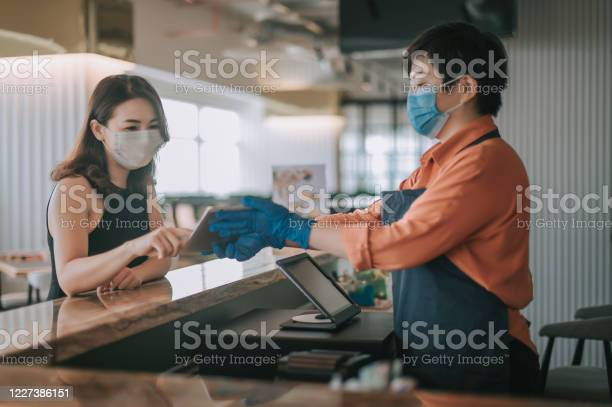 An asian chinese cafe owner businesswoman taking order from her at picture id1227386151?b=1&k=6&m=1227386151&s=612x612&h=zlecx17nc58ycd gcypzcatvkdovbcbp5py46oe hry=