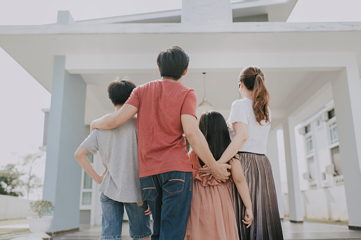 an asian chinese family moving into new house admiring their house