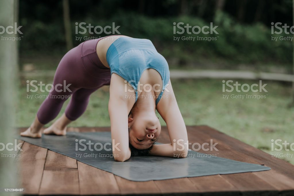 An Asian Chinese Female Yoga Instructor Demonstrating Yoga Poses Stock Photo Download Image Now Istock