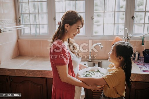 istock An Asian Chinese housewife having bonding time with her daughter in kitchen preparing food 1214401066