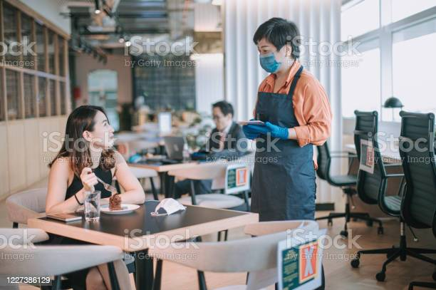 An asian chinese small business cafe owner woman talking to her for picture id1227386129?b=1&k=6&m=1227386129&s=612x612&h=hyl3zvxhyb4ad houy uuzgvhk1 nsybwss  x6fv9s=