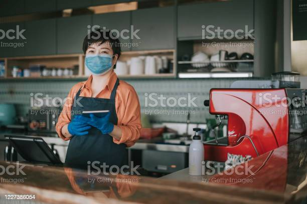 An asian chinese small business owner with face mask and protective picture id1227386054?b=1&k=6&m=1227386054&s=612x612&h= t jdl9asww4ldgbnuxb0tqafttjk3jenrgzy4zvbd0=