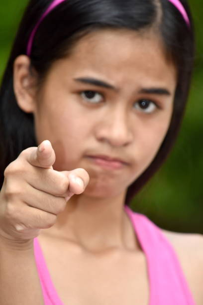 An Asian Girl And Anger A person in an outdoor setting antagonize stock pictures, royalty-free photos & images