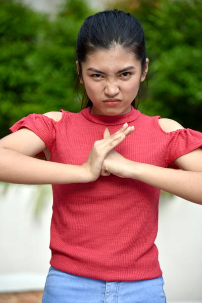 An Asian Juvenile And Anger A person in an outdoor setting antagonize stock pictures, royalty-free photos & images