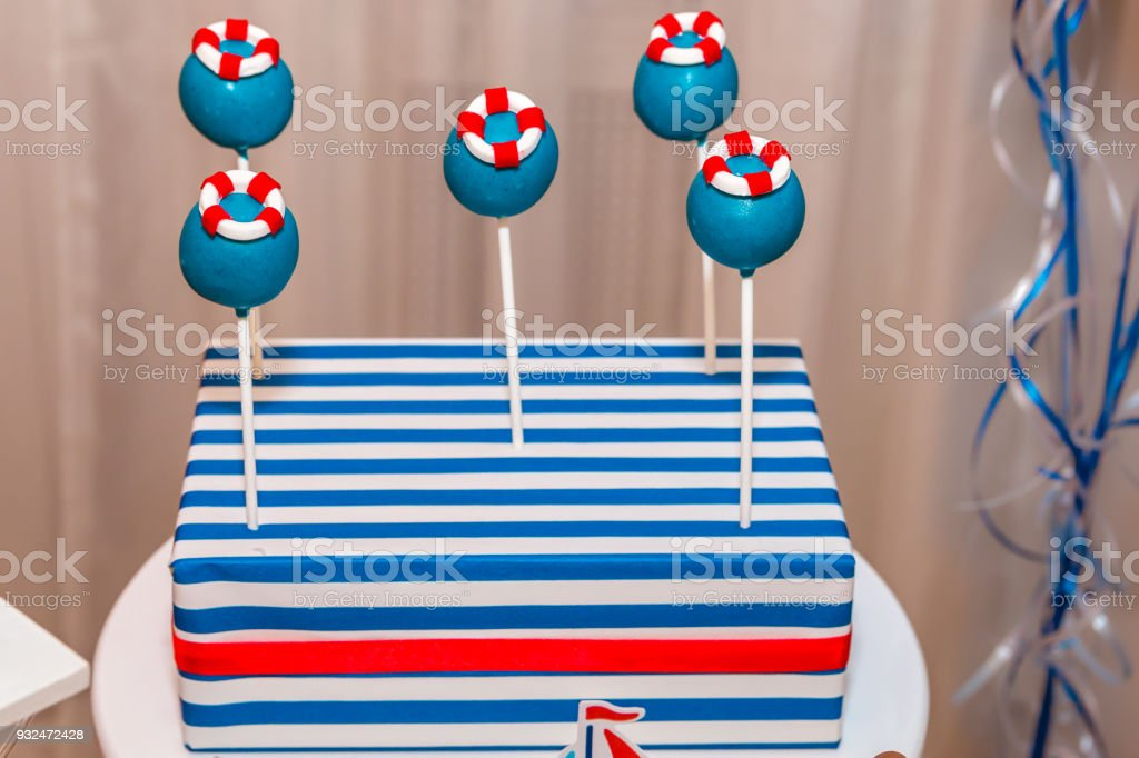 An assortment of colorful festive cake pops stock photo