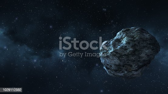 istock an asteroid or a meteorite flies in space, against the background of nebulae 1029112332