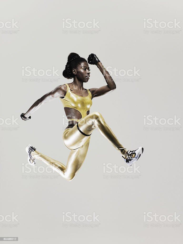 Un atleta Salto - foto stock