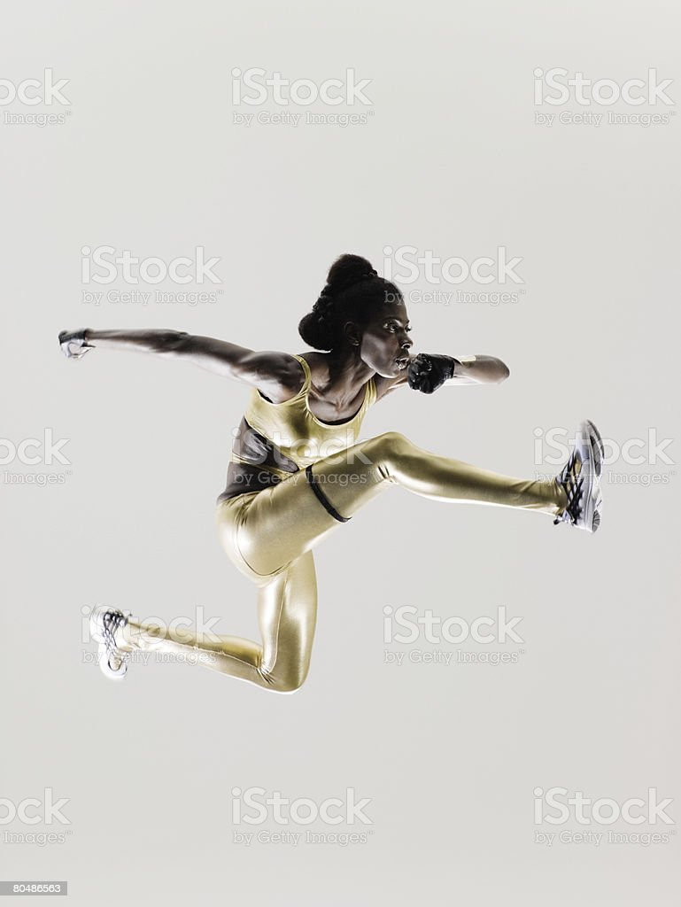 An athlete jumping stock photo