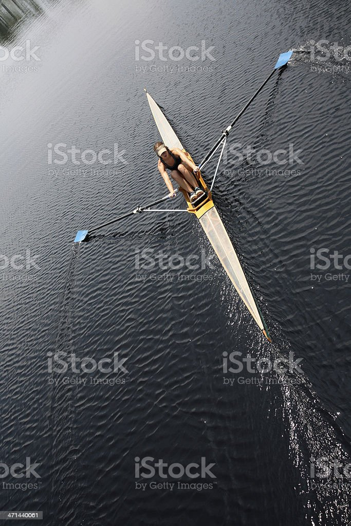 An athlete rowing and sculling down a river stock photo