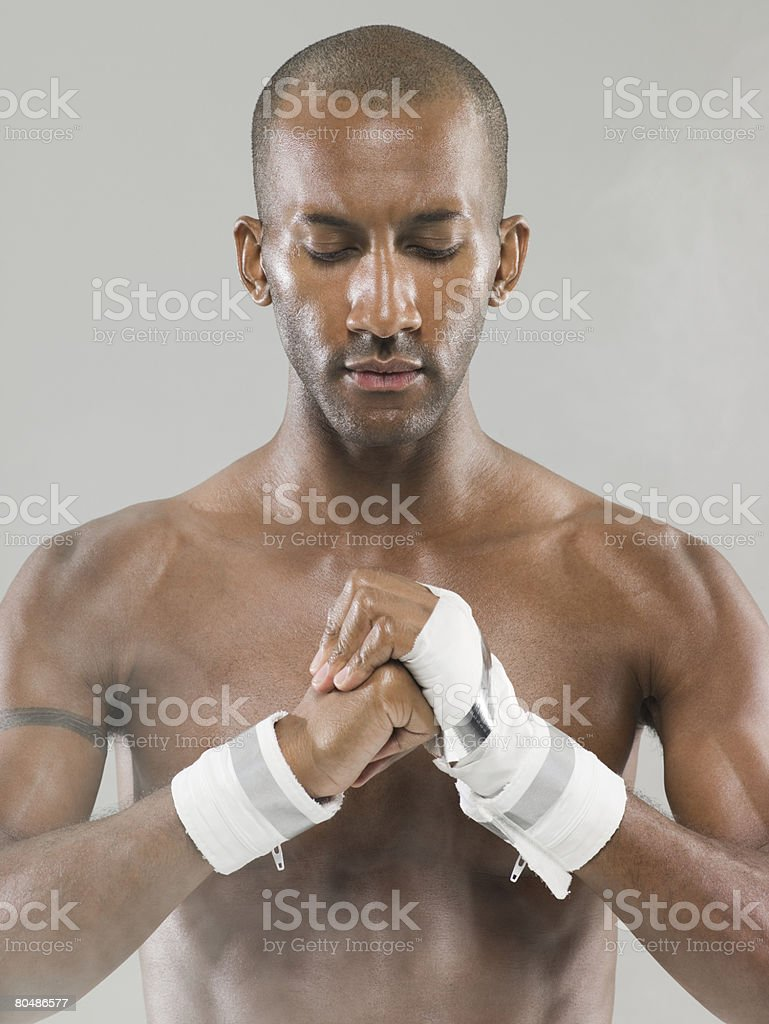 An athlete rubbing his hands with sports chalk royalty-free stock photo
