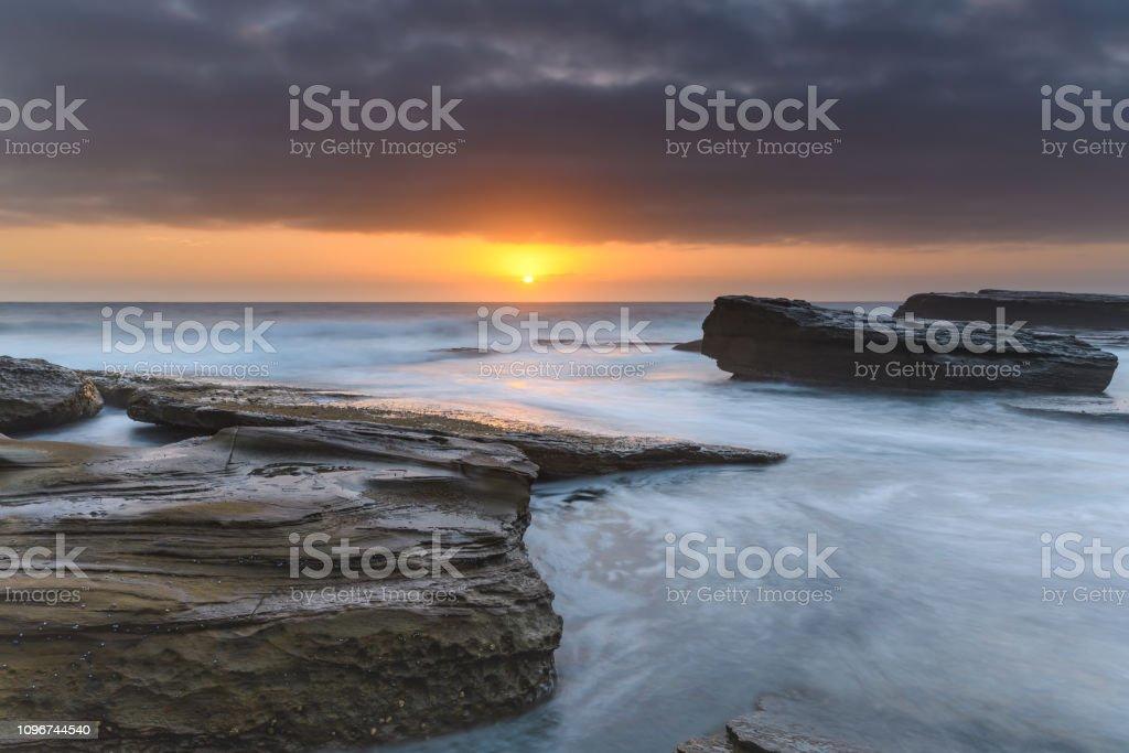 An Atmospheric Sunrise Seascape stock photo