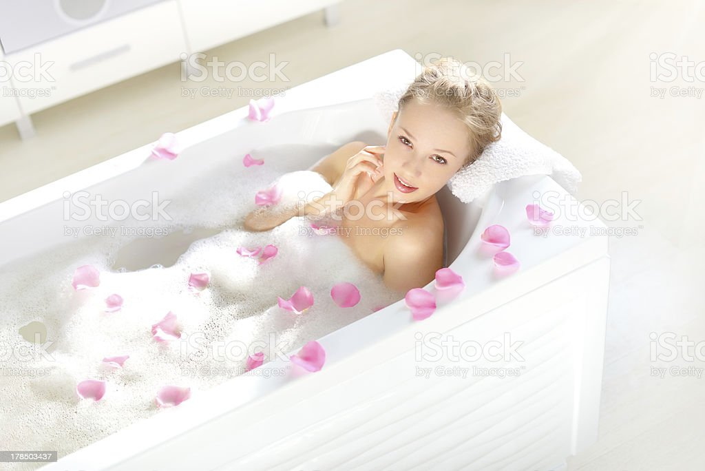 An Attractive girl relaxing in bath royalty-free stock photo