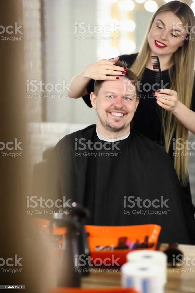 An attractive man came to hairdresser stock photo