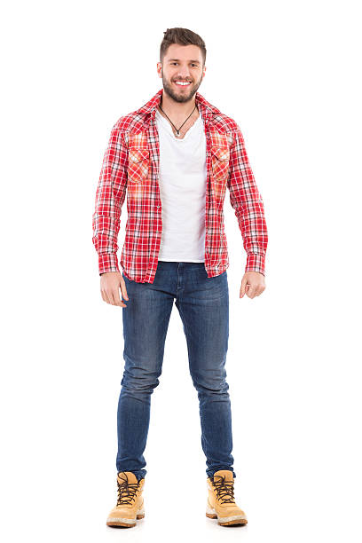 An attractive man in lumberjack shirt Handsome young man in jeans and lumberjack shirt standing and smiling. Full length studio shot isolated on white. plaid shirt stock pictures, royalty-free photos & images