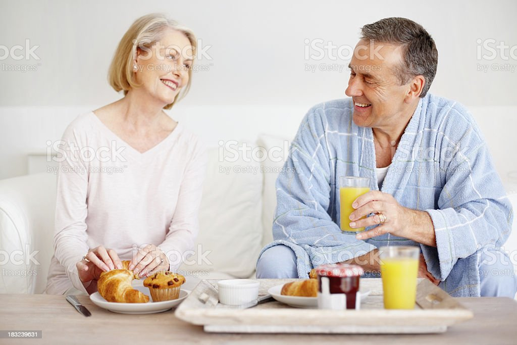 An attractive mature couple having breakfast at home royalty-free stock photo