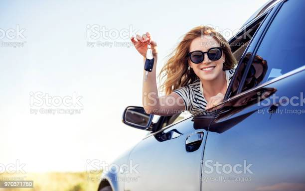 An attractive woman in a car holds a car key in her hand picture id970371780?b=1&k=6&m=970371780&s=612x612&h=tgv5sofza8jvqwdjfsqfctqfph0weqg gttvfpckkiq=
