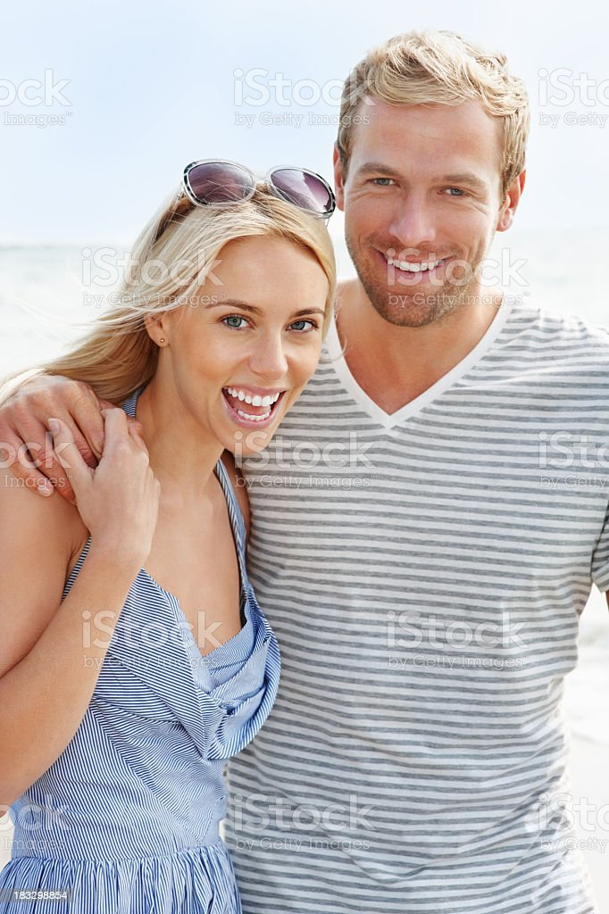 An attractive young couple together on the beach royalty-free stock photo