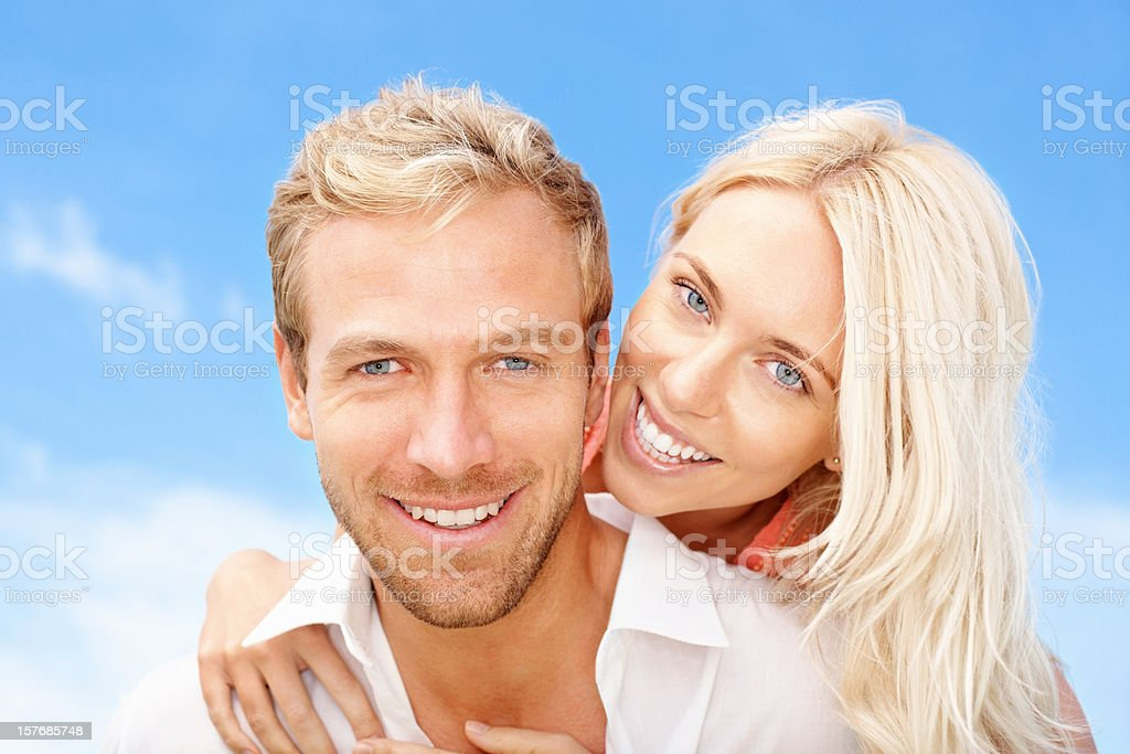 An attractive young woman embracing her handsome boyfriend stock photo