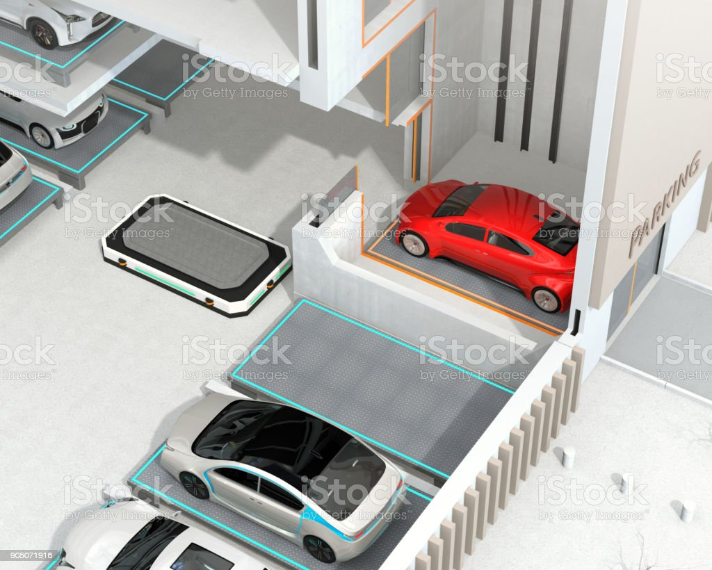 An Automated Guided Vehicle (AGV) prepare to carry a red car to parking space stock photo