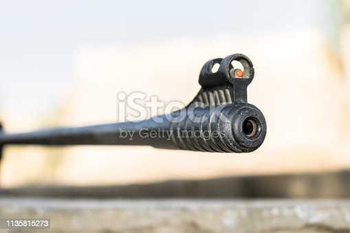 1048647890 istock photo an automatic riffle gun aim 1135815273
