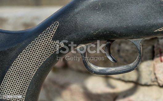 1048647890 istock photo an automatic riffle gun aim 1135815288