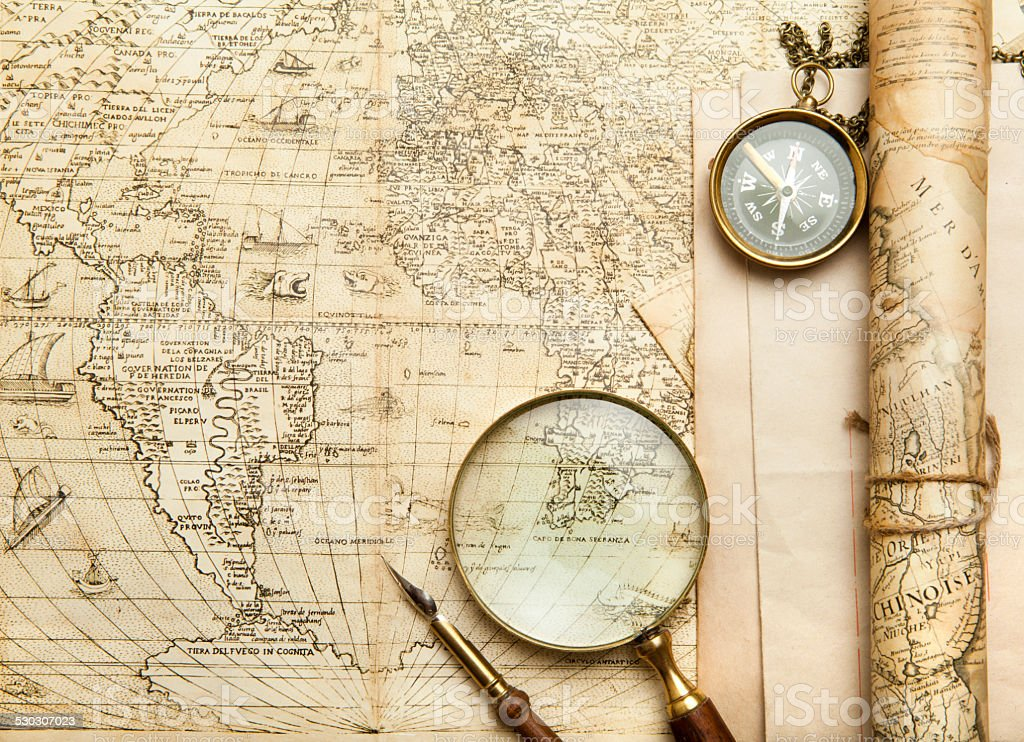 An brass compass on a old map background stock photo more pictures an brass compass on a old map background royalty free stock photo gumiabroncs Gallery
