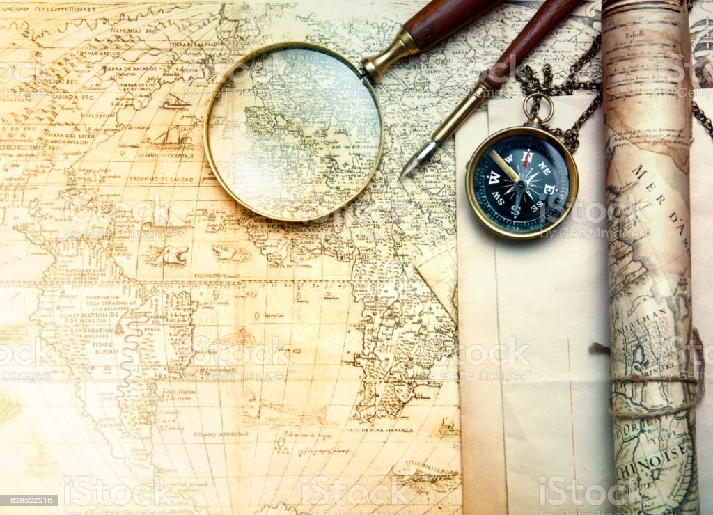 An Brass Compass On A Old Map Background Stock Photo More Pictures