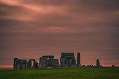 An early morning sky at the ancient circle at Stonehenge, Wiltshire, UK