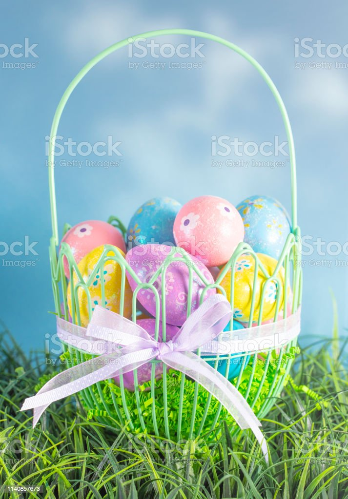 An Easter Basket Filled with Diecorated Eggs on a Clear Blue Sky Spring Day royalty-free stock photo
