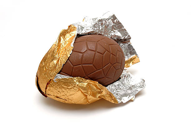 An Easter Chocolate Egg in a golden paper stock photo