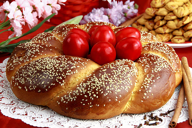 an easter sweet bread on a laid table - greek easter stock photos and pictures