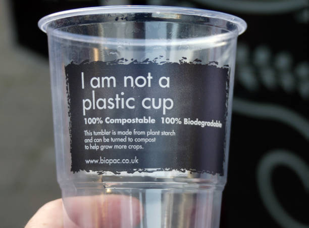 an eco friendly plastic cup, that is made form an alternative material. relevant to plastic waste and pollution - biodegradabile foto e immagini stock