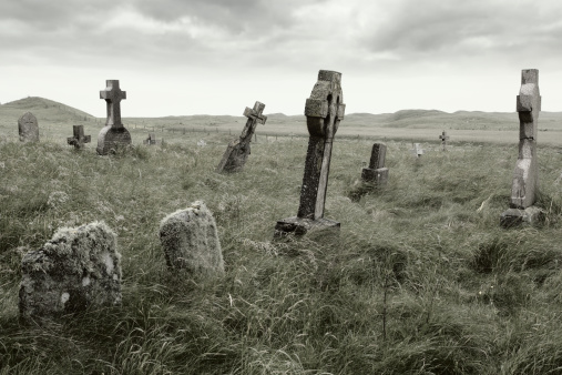 An eerie overgrown graveyard with moody lighting