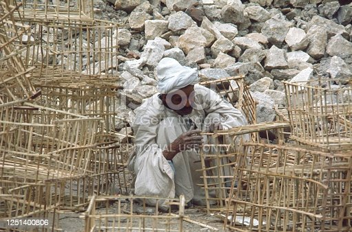 Egypt, 1974. An Egyptian builds poultry cages for the market.