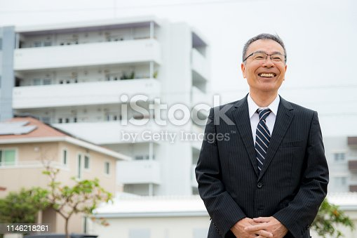 891418990 istock photo An elderly businessman. Business person with gray hair. 1146218261